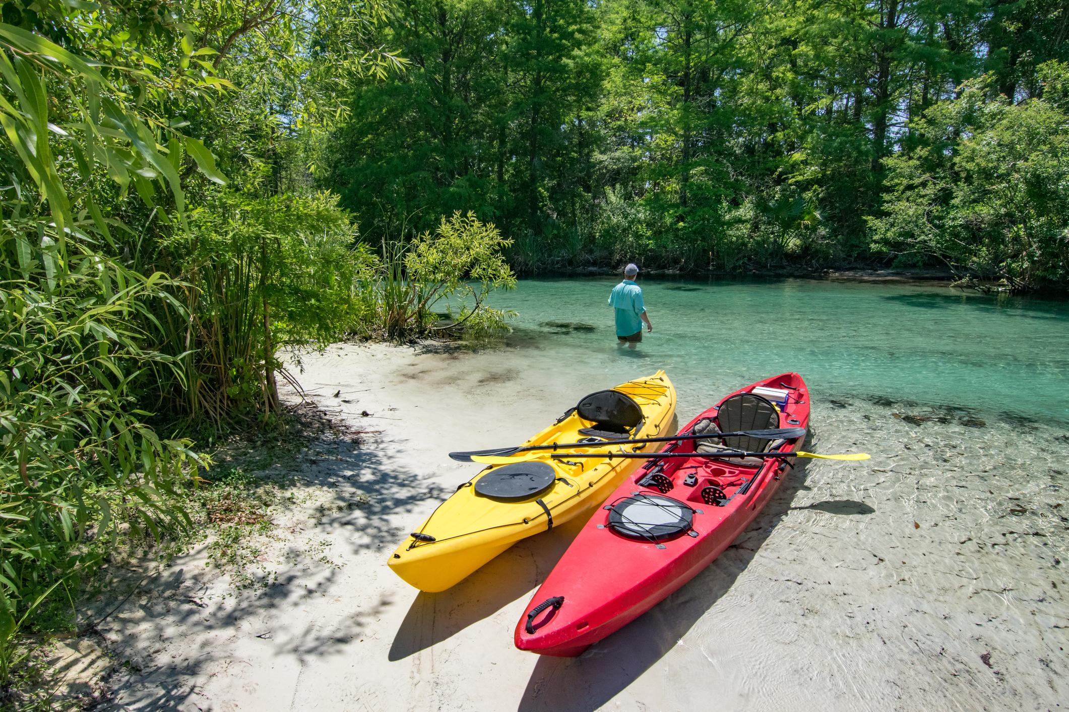 A lone kayaker cools off in the Weeki Wachee River in Florida representing Florida adventure bucket list