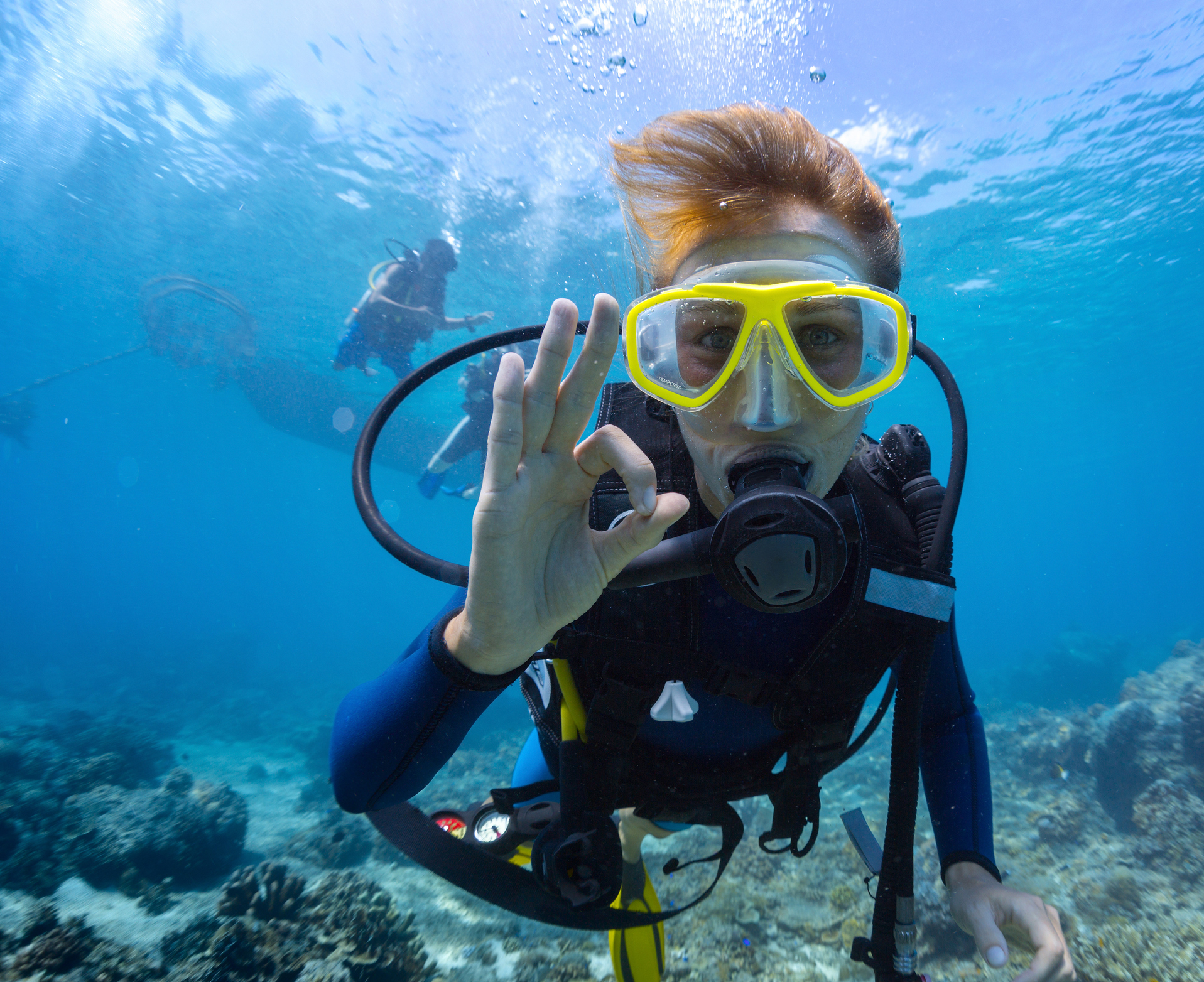 Female scuba diver underwater showing ok signal representing Scuba Diving around Tampa