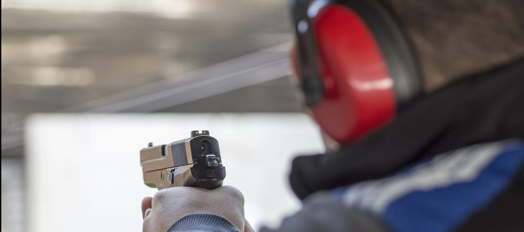 someone shooting in a shooting range