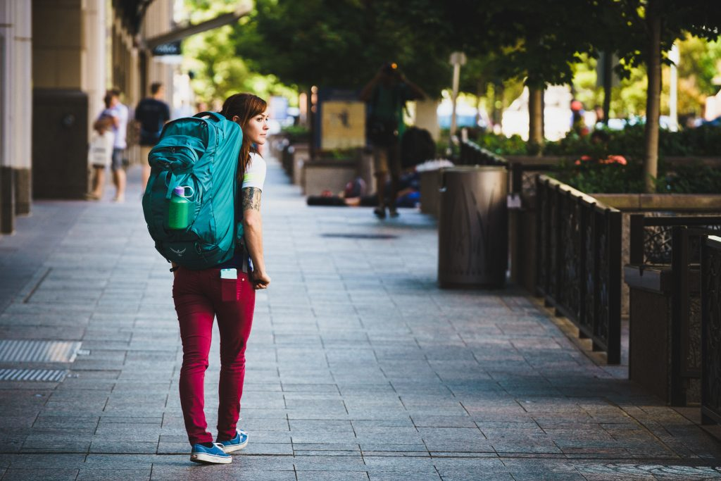 a girl walking representing backpacking tips